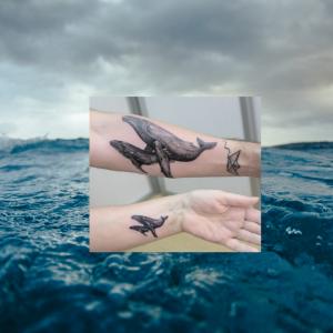 Imagen de una ballena y su hijo, uno de los tatuajes del chef Omar Páez